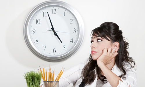 girl-watching-the-clock-at-work